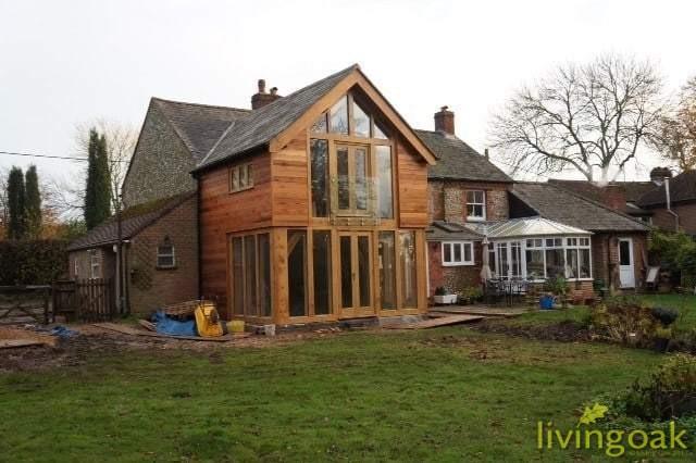 Gallery of oak framed buildings living oak for Two story farmhouse oak park