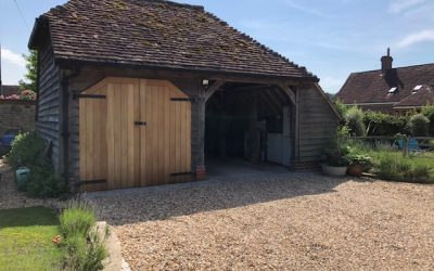Oak frame garage extension creates new home office in West Sussex